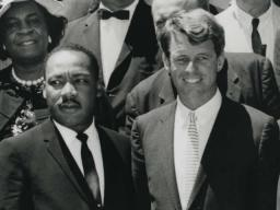 Attorney General Robert F. Kennedy stands besides the Reverend Martin Luther King, Jr.