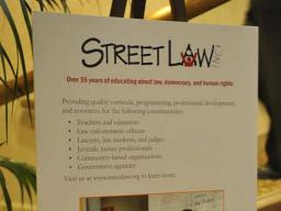Street Law program information greeting awards dinner guests.