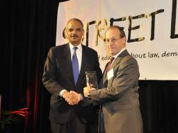 Attorney General Holder receiving the Chesterfield Smith Award from the Honorable Paul D. Clement.