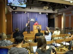Acting Assistant Attorney General Sharis Pozen takes questions from the media after the announcement is made.