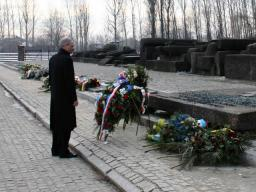 Attorney General Holder lays a wreath at the International Monument to the Camp Victims at the Auschwitz-Birkenau Memorial and State Museum.