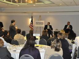 Attorney General Holder and Associate Attorney General Perrelli listen and respond to questions from the audience.