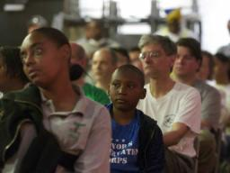 Volunteers listen to welcoming remarks before beginning work on the new Marvin Gaye Community Greening Center