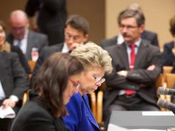 European Union Principal Vice-President and Commissioner for Justice Viviane Reding and EU Commissioner for Home Affairs Cecilia Malmström look over meeting materials.