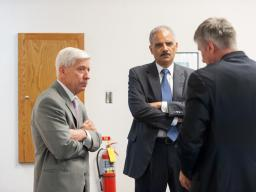 AG Eric Holder speaks with U.S. Attorney Richard Callahan and DAAG Mark Kappelhoff for the Civil Rights Division.
