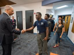 Attorney General Eric Holder greets students at the Florissant Valley Community College in north St. Louis.