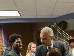 Attorney General Eric Holder hugs a student at the Florissant Valley Community College in north St. Louis.