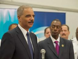 Mayor Mark Mallory looks on as Attorney General Holder speaks about the grant.
