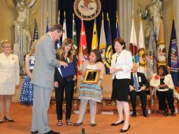 Fifth-grader Elisa Martinez, from Walter V. Long Elementary School, received the Missing Children's Art Contest Award.