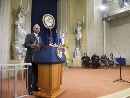 AG Holder delivers remarks at the installation ceremony for AAGs Virginia Seitz and Lisa Monaco.