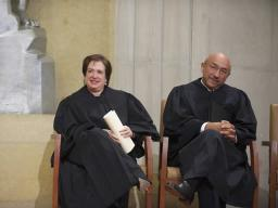 Justice Kagan and Judge Edwards listen as AG Holder speaks at installation ceremony.