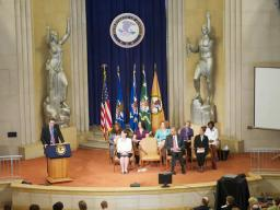 The view of the dais at the sexual assault awareness month commemoration, celebration of progress, and recommitment event.