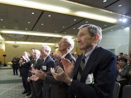 Guests stand and applaud at award ceremony