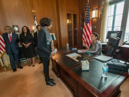 Director of Scheduling and Advance Meki Bracken briefs Attorney General Lynch prior to the swearing in ceremony in the Attorne