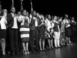 Students from Bedford Academy High School in Brooklyn lead the Pledge of Allegiance at Attorney General Loretta Lynch's invest