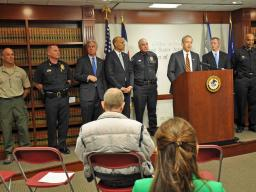 U.S. Attorney John Walsh, standing with local, state and federal law enforcement, announce the arrests of members of two separat