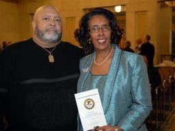 2009 AAG Individual Award recipient Brenda O'Connor and family member.