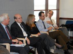 Officials at an Antitrust Division meeting.
