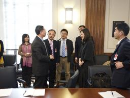 Department of Justice officials meet with Chinese government officials.