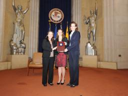 Helen Christodoulou, Caitlin Morrison, and Elizabeth Prewitt accept a 2011 Assistant Attorney General Team Award