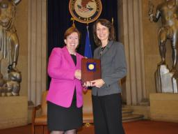 Acting Assistant Attorney General Sharis Pozen presents a 2011 Assistant Attorney General Award to Janet Ficco.