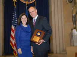Assistant Attorney General Christine Varney presents a 2009 AAG Individual Award to Joseph Matelis.