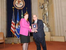 Acting Assistant Attorney General Sharis Pozen presents the 2011 Enforcement Support Award to Joseph Sutton.