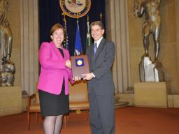 Acting Assistant Attorney General Sharis Pozen presents a 2011 Assistant Attorney General Award to Mark Hamer.