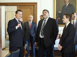 Ed Hand, Chief of the Antitrust Division'€™s Foreign Commerce Section, speaks with Igor Artemyev and Andrey Tsarikovski