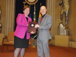 Acting Assistant Attorney General Sharis Pozen presents a 2011 Assistant Attorney General Award to Wayne Dunham.