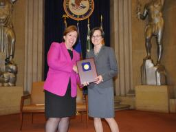 Acting Assistant Attorney General Sharis Pozen presents a 2011 Assistant Attorney General Award to Yvette Tarlov.
