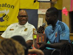 D.C. United goalkeeper Bill Hamid answers a child's question at Seaton Elementary.