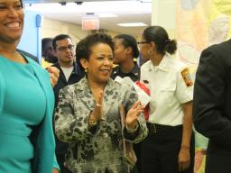 Attorney General Loretta E. Lynch and District of Columbia Mayor Muriel Bowser clap as a Seaton Elementary student reads an orig