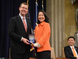 Acting Associate Attorney General Stuart F. Delery thanks Chair Yang after she delivers the keynote address.