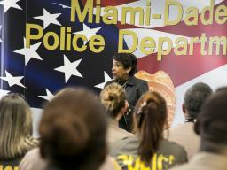 Visiting with Miami-Dade Police Department Officers, Attorney General Lynch thanks them for their service to the community.