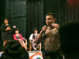 Attorney General Lynch, Student Peace Ambassadors, and officers discuss police-community relations at a youth down hall at Miami