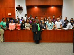 A group shot with U.S. District Judge Charlene Edwards Honeywell.