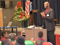 Mr. Ricky Gallon from the Boys and Girls Club of Tampa Bay speaks during the breakfast.