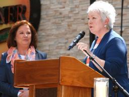 U.S. Attorney Tammy Dickinson presented the Lifetime Achievement Award to former Assistant U.S. Attorney Katharine Fincham.