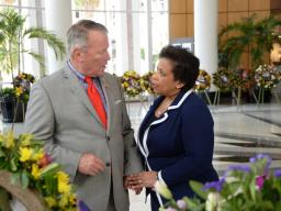 Attorney General Loretta E. Lynch holding hands with Orlando City Mayor Buddy Dyer at the Orlando City Hall memorial site.