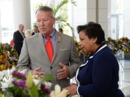 Attorney General Loretta E. Lynch and Orlando City Mayor Buddy Dyer view the wreaths of the victims at the Orlando City Hall m