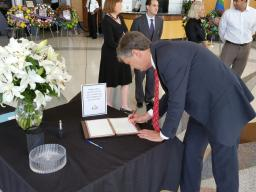 USA Bentley penning a note for victims at Orlando's city hall.