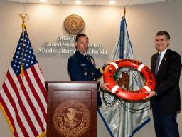 Rear Adm. DeQuattro presents USA Bentley  life ring from USS Bertholf