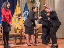 Attorney General Loretta Lynch congratulates one of America's newest citizens