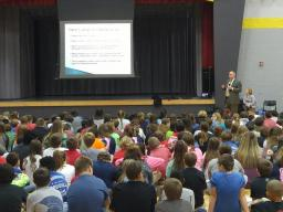 Acting U.S. Attorney Carlton Shier speaks to middle school students in Richmond