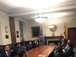 High school students from Communities in Schools of Atlanta with Assistant Attorney General Makan Delrahim, along with Principal Deputy Assistant Attorney General Andrew Finch and Chief of Staff John Elias sitting at the AAG's conference table.