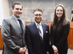 AAG Makan Delrahim (center) joined by George Washington University Law School Students