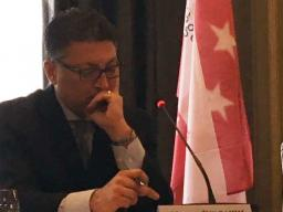 AAG Delrahim in front of microphone