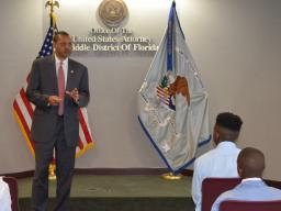 Public Affairs Officer William Daniels congratulates the students.