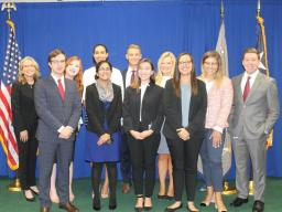 College student interns gather to say farewell after a hard working summer at the U.S. Attorney's Office.